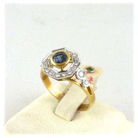 Anello in oro giallo e bianco 18kt. zaffiro blu e diamanti